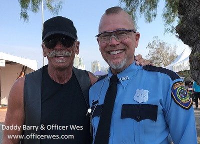 Daddy Barry, Sir, with his boy, Officer Wes at San Diego LGBTQ Pride 2017 in the Leather Realm